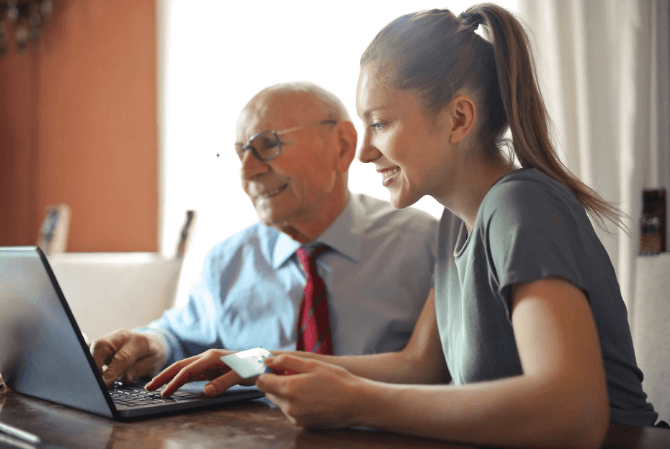 Man-and-woman-using-laptop