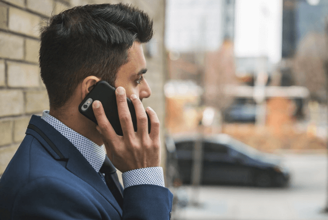 man-contacting-via-phone