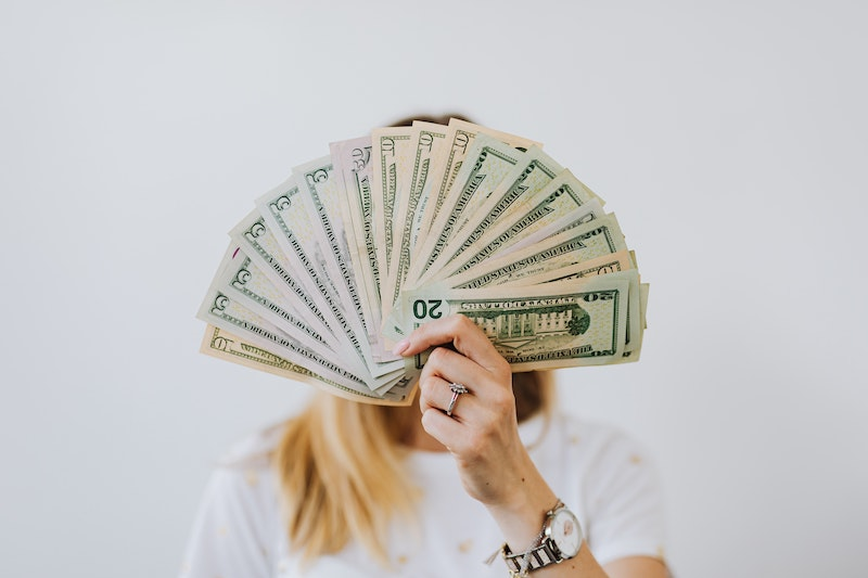 Woman-holding-payday-loan